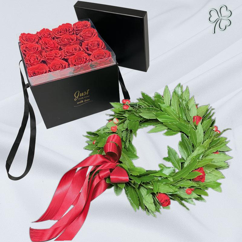 Corona di laurea con fiori e fiocco rossi, flower box di rose stabilizzate rosse.