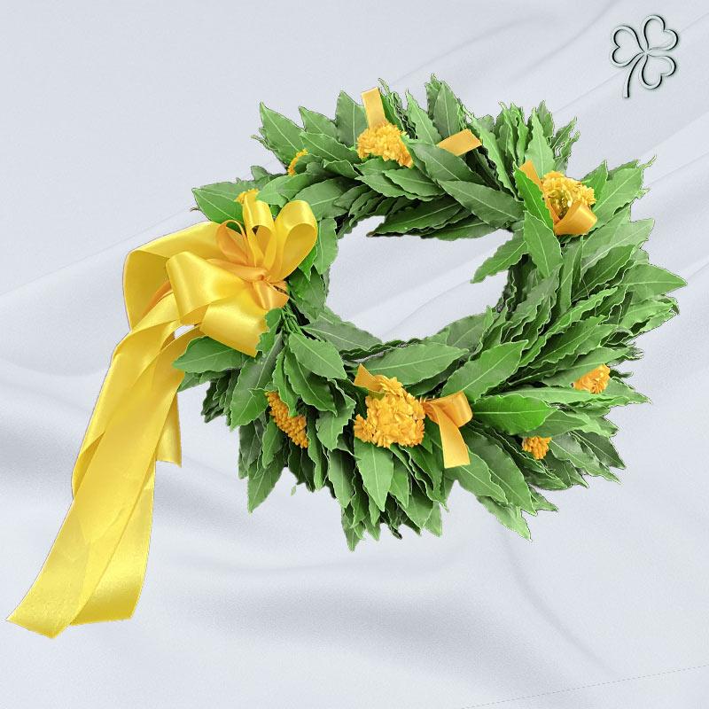 Corona di laurea con fiori gialli - Facoltà di Economia.